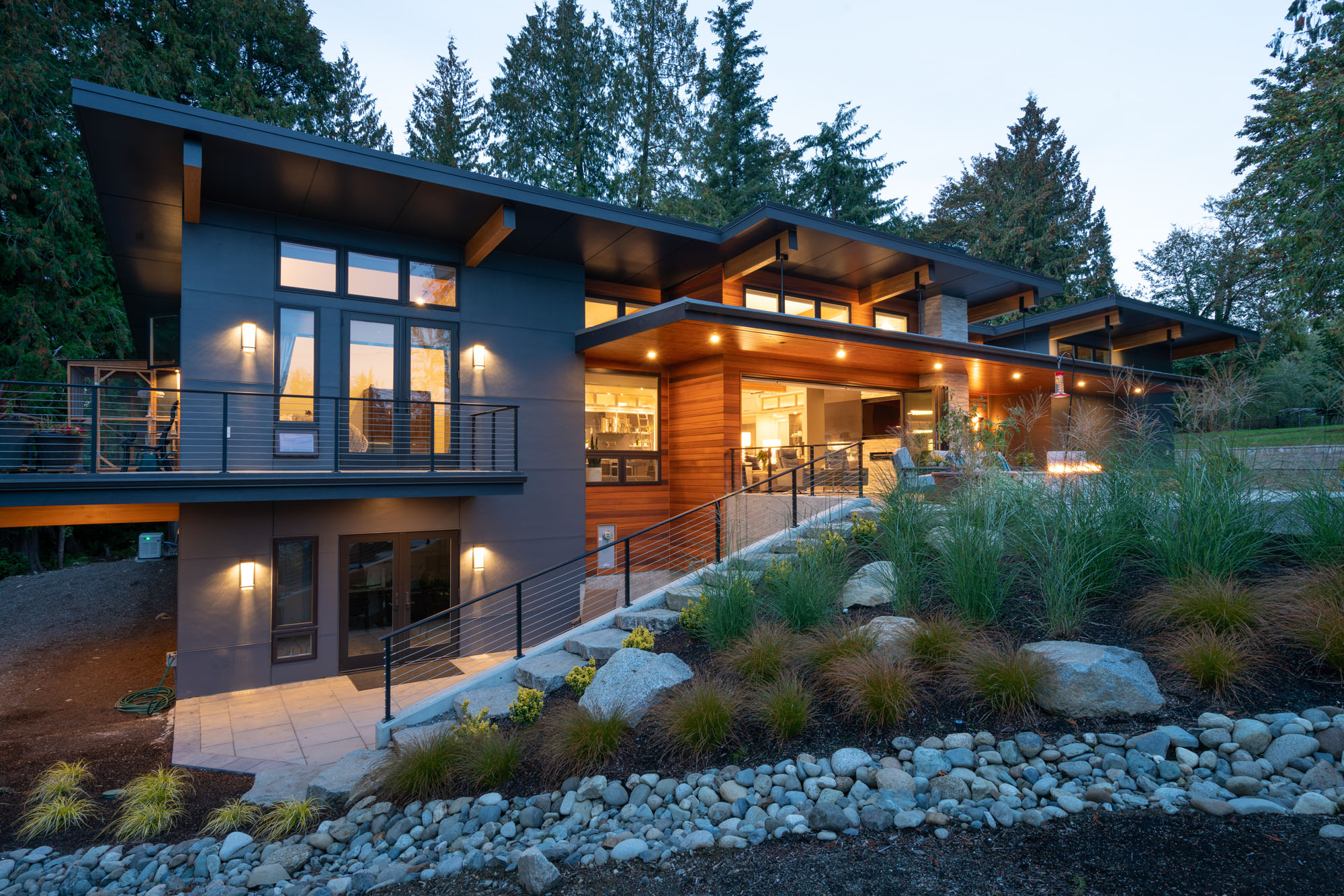 Fifth slide - Modern home in Redmond Washington with a fir beam canopy in a terraced landscape